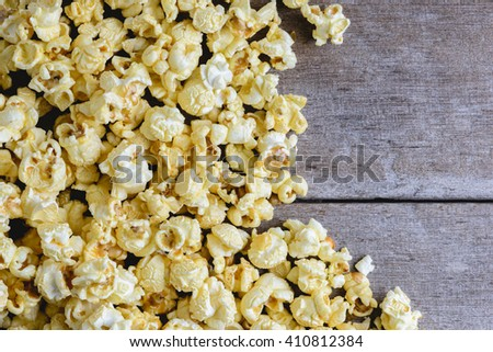 popcorn texture and wooden background - stock photo