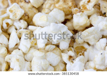 popcorn texture, popcorn grains on the white background - stock photo