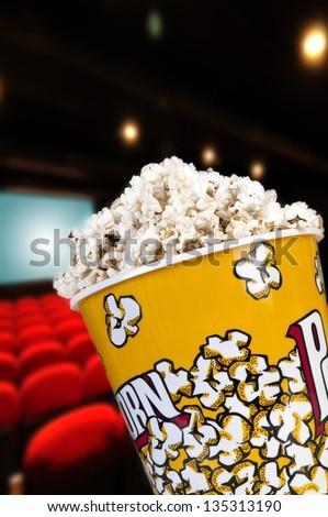 Popcorn to watch a movie entertaining - stock photo