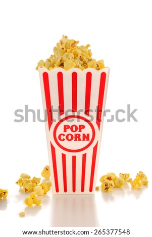Popcorn with butter in container and on table isolated over white background - stock photo