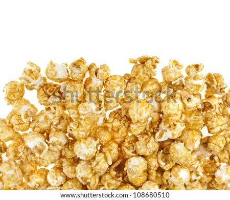 popcorn with caramel  isolated on white - stock photo