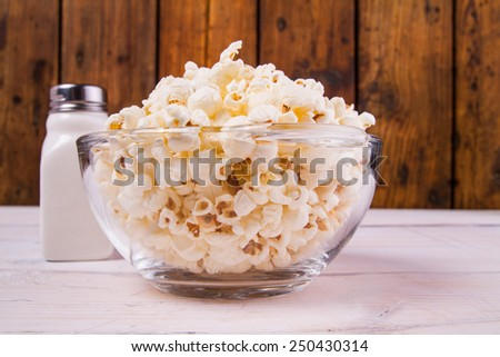Popcorns and salt shaker - stock photo