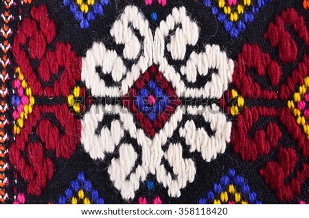 POPOVO, BULGARIA - December 26, 2015 - Ethnographic Museum folklore female national costume and embroideries in Popovo, Bulgaria.Bulgarian hand embroidery texture in old style with woolen thread