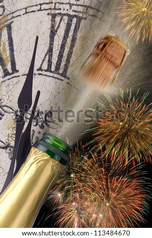 popping champagne  and watch at new year - stock photo