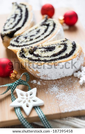 poppy seed cake with christmas decoration - stock photo