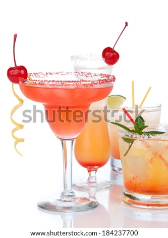 Popular alcoholic cocktails composition. Many cocktail drinks mai tai, tropical Martini, tequila sunrise, margarita cherry, lime, lemon, straw on a white background - stock photo