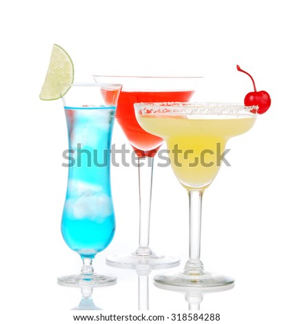 Popular alcoholic cocktails drinks yellow margarita cherry blue curacao and tropical Martini on a white background - stock photo