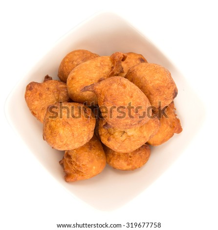 Popular Malaysian fritter snack deep fried banana balls or locally known as Cekodok Pisang over white background