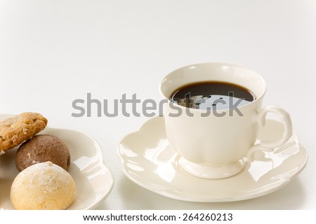 Porcelain coffee cup and tasty cookies