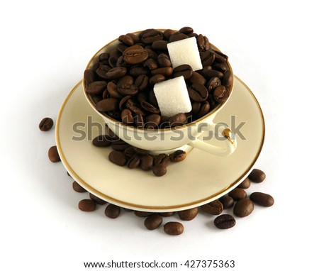 Porcelain cup and coffee beans on white background