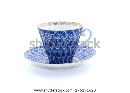 Porcelain cup and saucer on white