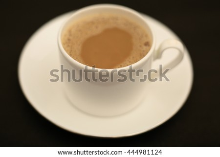 Porcelain cup of tea with milk. - stock photo