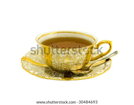 Porcelain cup with a saucer and nickel silver spoon from a tea-set - stock photo