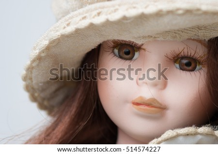 porcelain doll's face on a white background