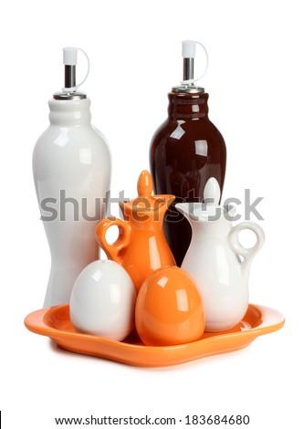 Porcelain jar and a salt shaker on white background - stock photo