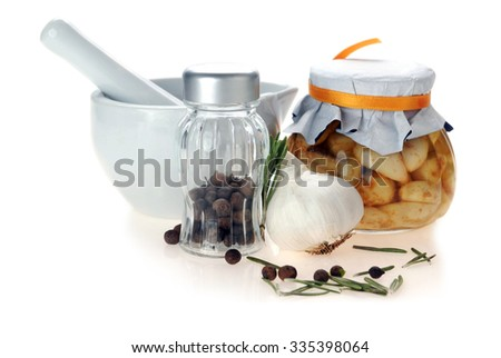 porcelain mortar and pestle with spices - stock photo