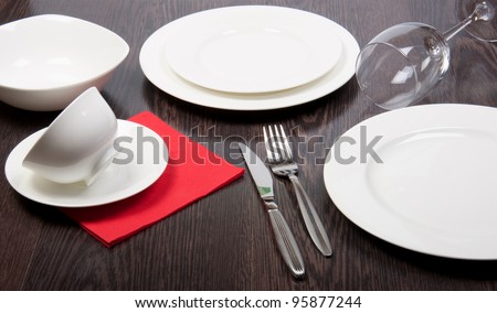 porcelain plate on dinner table - stock photo