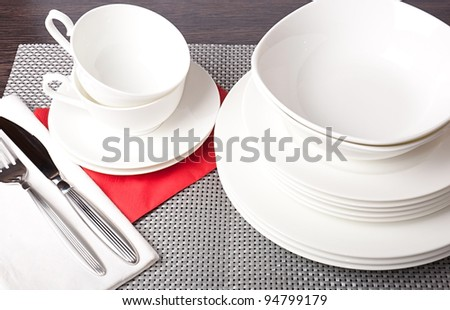 Porcelain plates, cups and saucers - stock photo