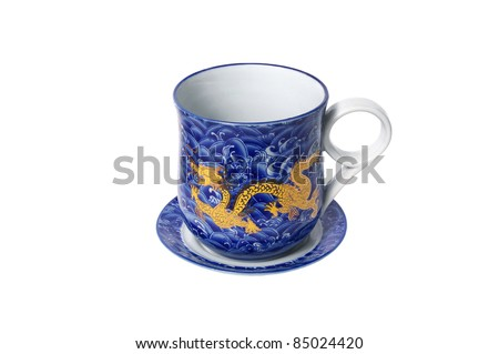 Porcelain saucer and cup  with a dragon pattern isolated on white background