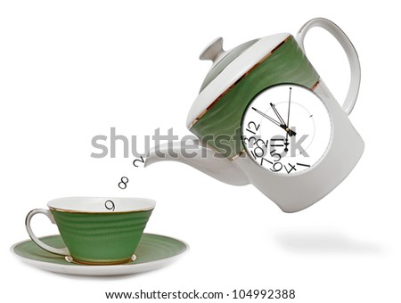 porcelain teapot with clock on the front. tea time - stock photo