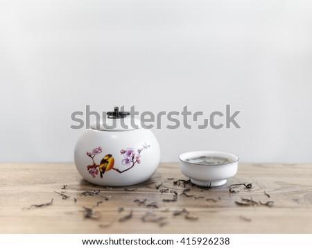 porcelain ware and tea - stock photo