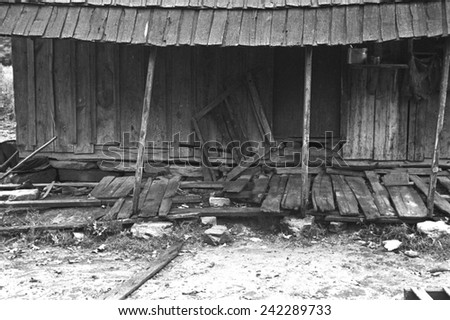 Porch of a barely standing home of a poor farmer in Boone County, Arkansas. New Deal relief and loan programs offered poor farmers medical care. Ben Shahn photo, Oct. 1935.