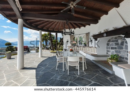 Porch of a beautiful house with ornamental garden, lake view