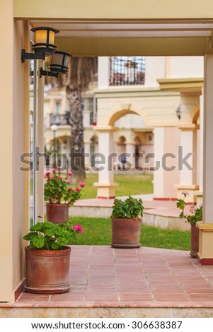 Porch rustic Villa in Tuscan style with flowers in ceramic pots