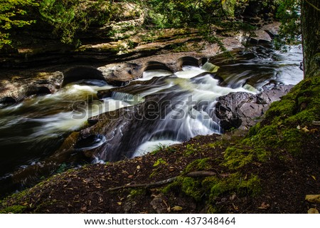 Porcupine Mountains State Park. The Presque Isle River carves it's way through rock as it flows towards Lake Superior. Porcupine Mountains State Park.  North Country Trail. Ontonagon, Michigan. - stock photo
