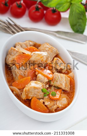 Pork and carrot stew in a white bowl - stock photo