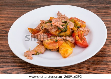 Pork and pineapple salad with tomato and spicec