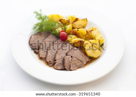 Pork and potatoes dish isolated on white background
