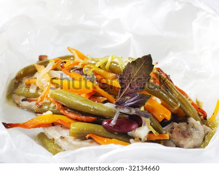 Pork and Vegetables in Paper Served with Basil Leaves