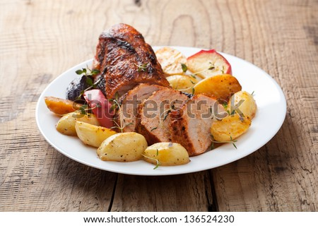 pork baked with vegetables - stock photo