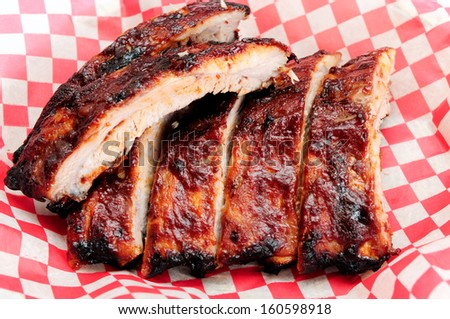 pork bbq ribs, meaty ribs smothered with bbq sauce - stock photo