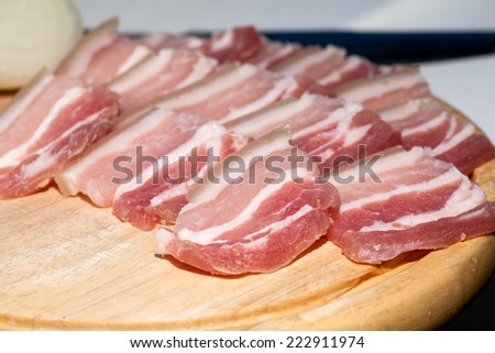 Pork Belly Cut Into Thin Slices On A Wooden Board