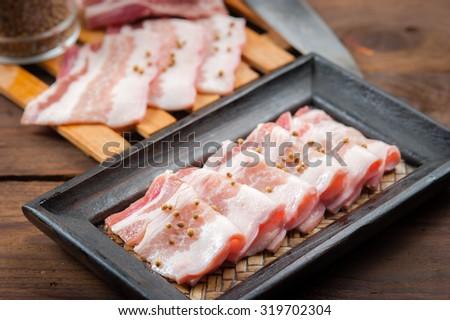 Pork belly sliced on wood - stock photo