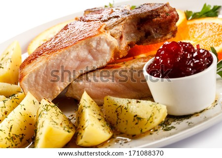 Pork chop and boiled potatoes  - stock photo