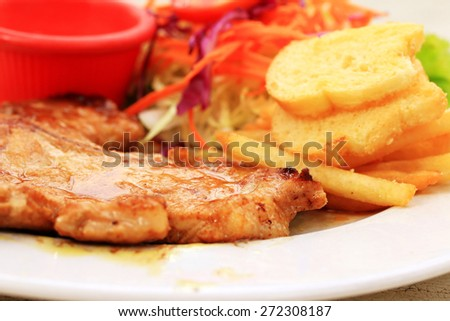 Pork chop, french fries with salad