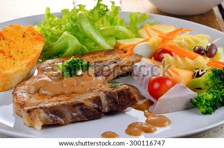 Pork chop steak with salad