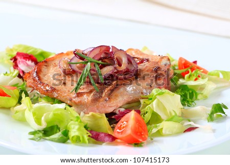 Pork chop with green salad