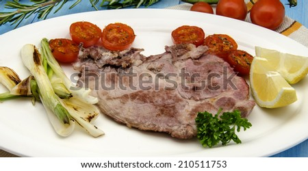 Pork chop with onions and tomatoes