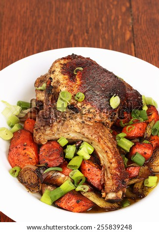 Pork chop with roasted vegetables - stock photo
