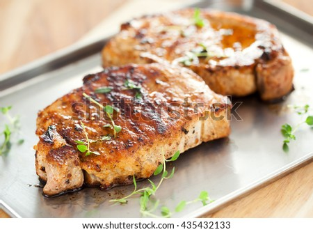 pork chop with thyme on tray