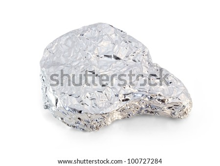 Pork chop wrapped in aluminum foil and isolated on white. - stock photo