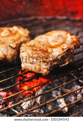 Pork chops on a grill (selective focus)