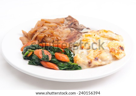pork chops with potatoes gratin and spinach - stock photo