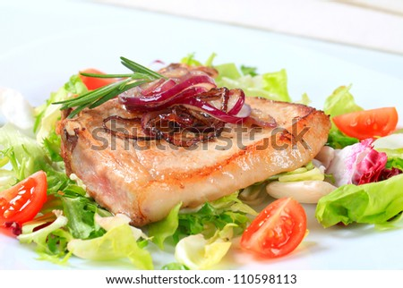 Pork cutlet with green salad
