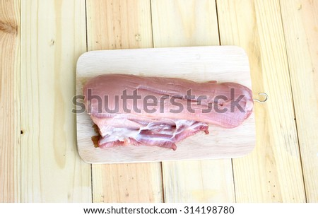 Pork fillet. Raw meat on chopping board