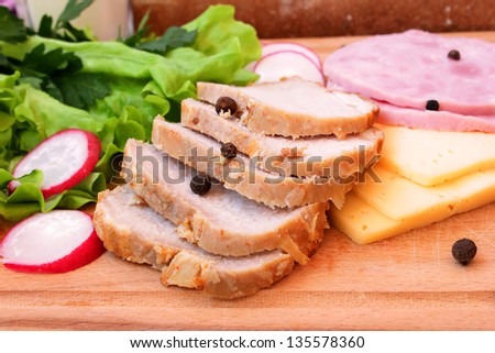 pork, ham, cheese and vegetables